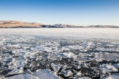 Ice and snow on the lake — Stock Photo