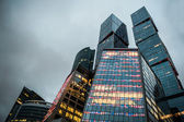 Modern skyscrapers of the business center at evening lights — Stock Photo