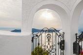 Decorative gates in hotel. White architecture on Santorini islan — Photo