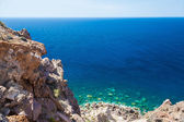 Rocky beach and clear turquoise water of the Aegean sea — Stock Photo
