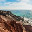 View of the seacoast and the beautiful Red beach. — Stock Photo #68741129