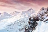 Winter snow-covered mountains at sunset. — Foto de Stock