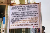 Historical sign at Checkpoint Charlie in Berlin — Stock Photo