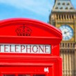Red telephone booth in London — Stock Photo #72604785