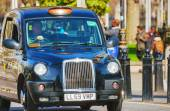 Famous black cab an a street in London — Stock Photo