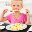 Cute girl eating lunch in cafe — Stock Photo #52966559