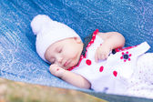 Cute little baby sleeping in the park — Photo