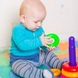 Cute little baby playing with colorful toys — Stock Photo #57383773