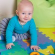 Cute little baby playing with colorful toys — Stock Photo #57383815