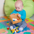 Cute little baby playing with colorful toys — Stock Photo #57383839