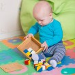 Cute little baby playing with colorful toys — Stock Photo #57383859