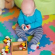 Cute little baby playing with colorful toys — Stock Photo #57383889