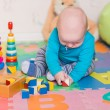 Cute little baby playing with colorful toys — Stock Photo #57383913