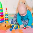 Cute little baby playing with colorful toys — Stock Photo #57383927