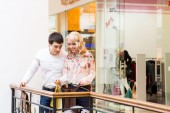 Happy young couple with shopping bags — Stock Photo