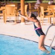 Cute little girl is ready to jump into pool — Stock Photo #62087781