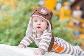 Cute little baby lying in the park — Foto de Stock