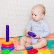 Cute little baby playing with colorful toys — Stock Photo #67807649