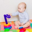 Cute little baby playing with colorful toys — Stock Photo #67807657