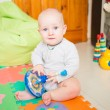 Cute little baby playing with colorful toys — Stock Photo #67808721