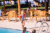Cute little girl in swimming pool — Stock Photo