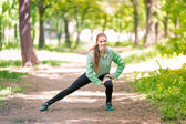 Fit sportive women stretching in the park — Foto de Stock
