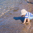 Cute little baby boy exploring the beach — Stock Photo #76288439