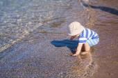 Cute little baby boy exploring the beach — Stock Photo