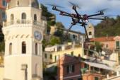 Flying drone in an old city — Stock Photo