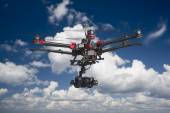 Drone flying in the clouds — Stock Photo