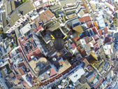 Quadcopter flying over roofs — Stock Photo