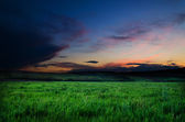 Field and dramatic sky view — Stock Photo
