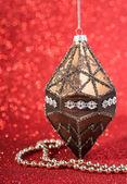 Festive christmas vintage decoration bauble on glitter red background. seasonal winter holidays — Stock Photo