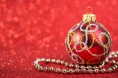 Festive christmas vintage decoration bauble on glitter red background. seasonal winter holidays — Stock Photo