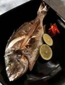 Dorado fried, fish with lemon — Stock Photo