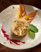 Delicious restaurant dessert, fried ice cream served with whipped cream and fruit coulis — Stock Photo
