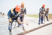 Builders mount bridge span — Stock Photo