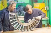 Mechanics assembles parts for aviation engine — Stok fotoğraf