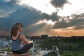 Attractive girl meditating at sunbeam — Foto Stock