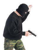 Masked man with gun — Stock Photo