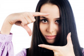 Pretty girl with frame gesture. Focus on fingers — Stock Photo