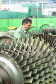 Mechanic works with part of aviation engine — Stok fotoğraf