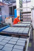 Worker at machine on stone blocks drying — Stock Photo