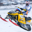 Sport snowmobile jump on track — Stock Photo #53937511