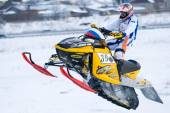 Sport snowmobile jump on track — Stock Photo