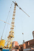 Crane on house construction — Stock Photo