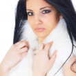 Pretty girl wearing white fur — Stock Photo #55043979