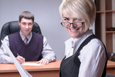 Young and smiling business lady in office — Stock Photo