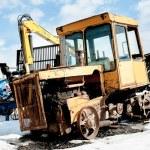 Old tractor among new equipment. Tyumen. Russia — Stock Photo #55352047