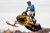 High jump of sportsman on snowmobile — Stock Photo